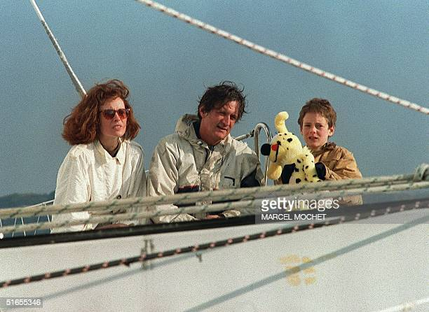 Skipper Olivier de Kersauson accompanied by his wife Caroline and their son Arthur poses for photographers after his arrival into the Brest harbor 03...