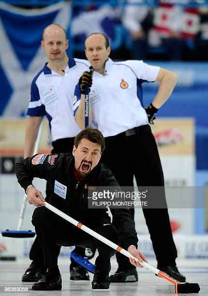 US skipper Pete Fenson shouts after shooting the stone during the Men's curling World Championship final for the Bronze Medal against Scotland in...