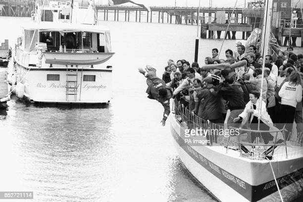 Skipper Pierre Fehlmann of the Swiss yacht 'UBS Switzerland' takes the plunge in Gosport Marina in Portsmouth after winning the Whitbread Round The...