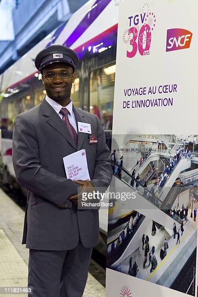 A skipper poses in front of the TGV Train during a SNCF presentation at Gare Montparnasse on April 7 2011 in Paris France French train company SNCF...