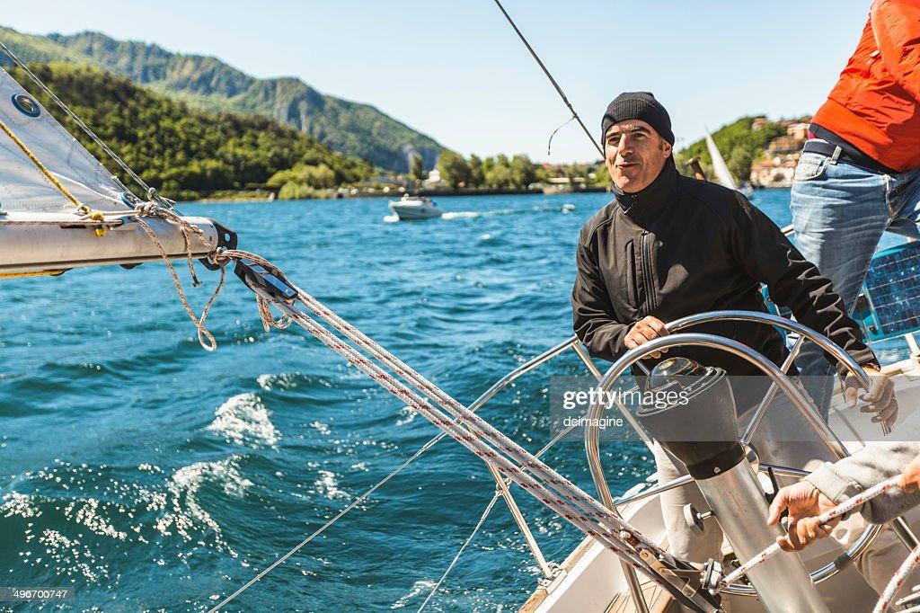 Skipper Sail boat : Stock Photo