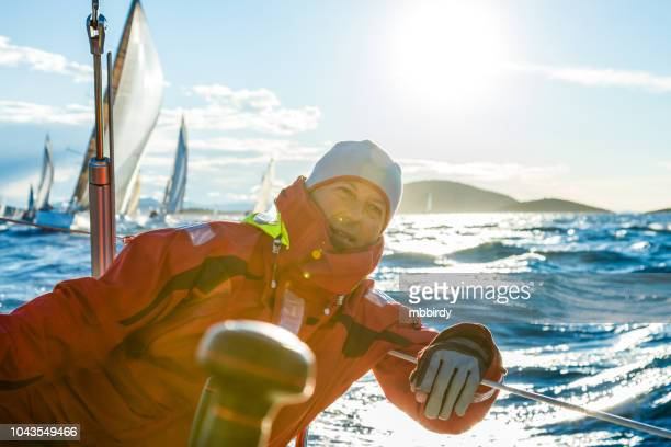 skipper sailing on sailboat during regatta - sailing team stock pictures, royalty-free photos & images