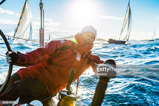 Skipper sailing on sailboat during regatta