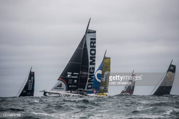 Skippers aboard their Imoca 60 monohulls take the start of the Vendee-Arctic-Les Sables d'Olonne solo monohull sailing race, on July 4 in Les...