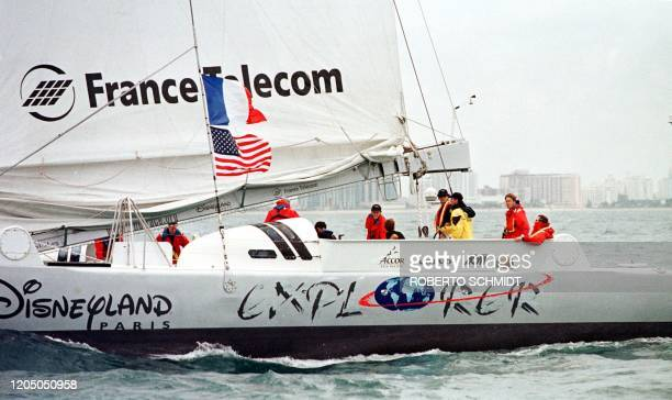 Skippers Bruno Peyron of France and Cam Lewis of the US along with a small crew sail their 86foot catamaran Exploreroff the coast of Miami Beach 30...