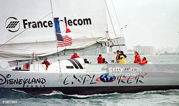 """Skippers Bruno Peyron of France and Cam Lewis of the US along with a small crew sail their 86-foot catamaran """"Explorer""""off the coast of Miami Beach..."""