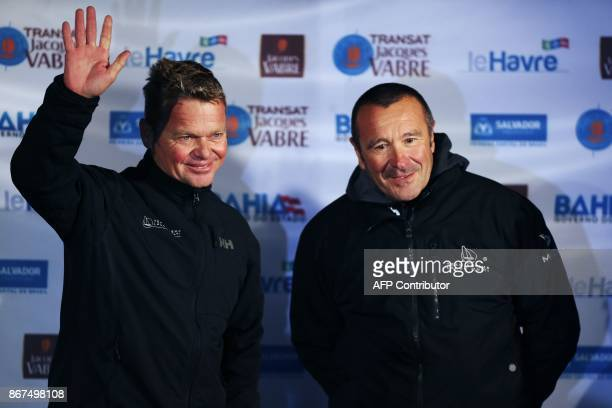 Skippers of the 'Arkema' multihull Muti50 Alex Pella and Lalou Roucayrol pose in Le Havre northwestern France on October 28 during the skippers'...