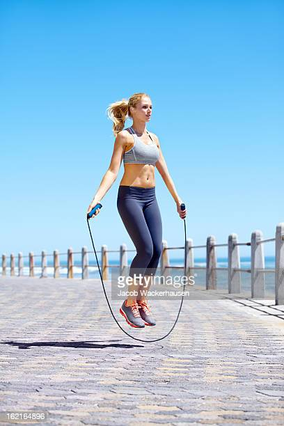 skipping is a great full body work out - skipping along stock pictures, royalty-free photos & images