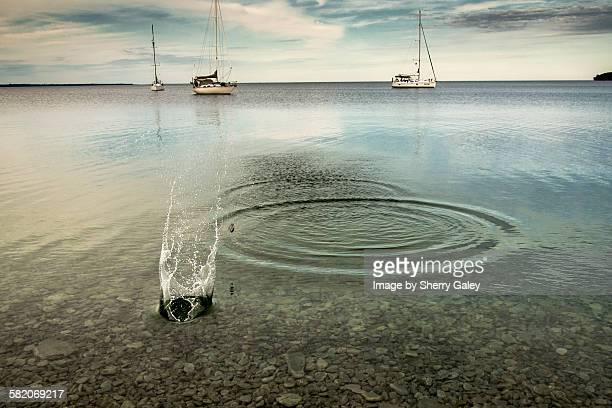 Skipping stones in a crystal clear bay