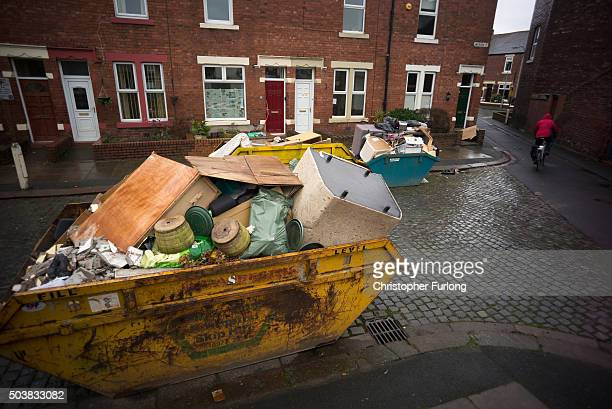 Skips line the roads as the clear up and rebuilding of flood damaged property and homes continues one month on from the devasting floods created by...
