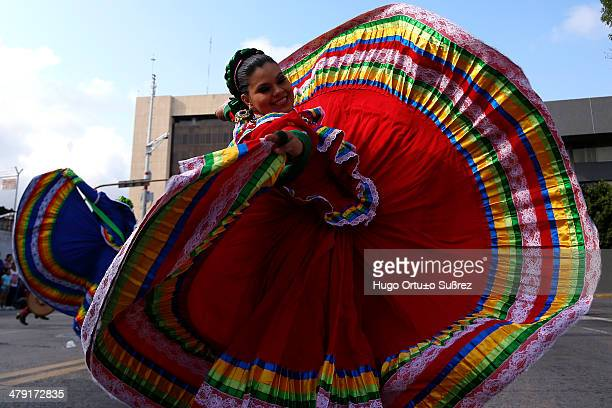 CONTENT] GUADALAJARA JALISCO MEXICO SEPTEMBER 01 A skirmish rehearse a regional dance before the parade for the XX International Mariachi and...