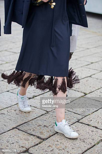 Skirt details and Adidas Stan smith sneakers outside the Gucci show during Milan Fashion Week Spring/Summer 2017 on September 21 2016 in Milan Italy
