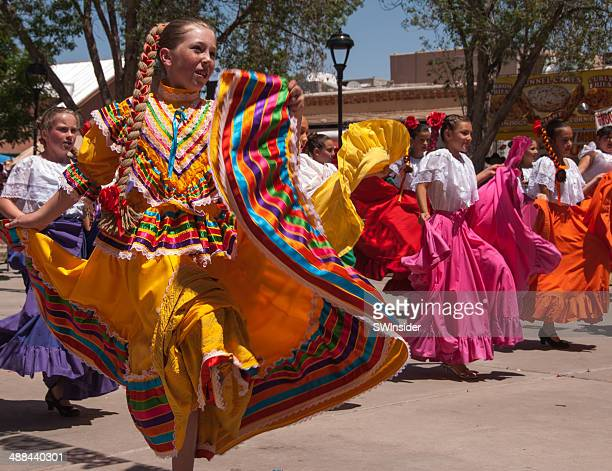 skirts swirl in authentic mexican folk dancing - mexican fiesta stock pictures, royalty-free photos & images