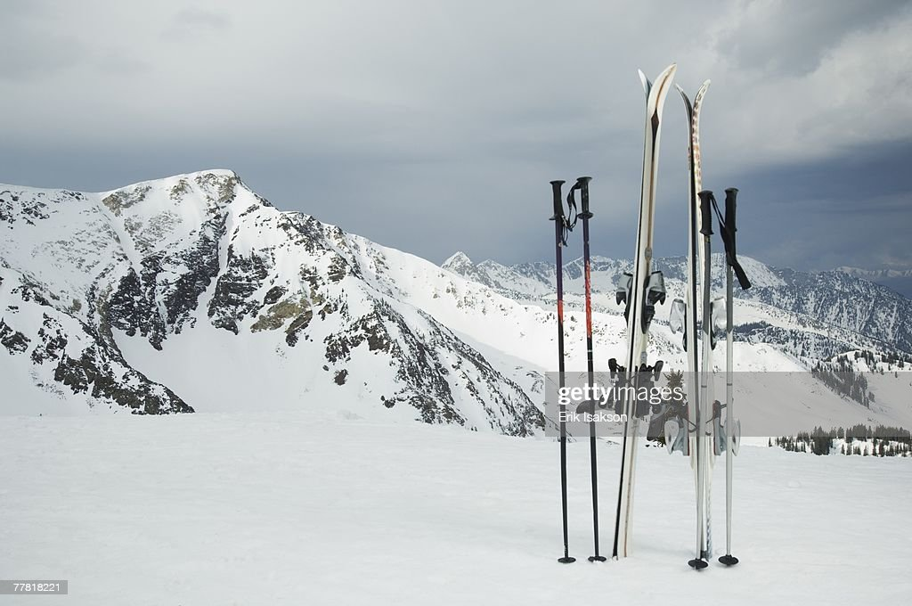 Skis and poles stuck in snow : ストックフォト