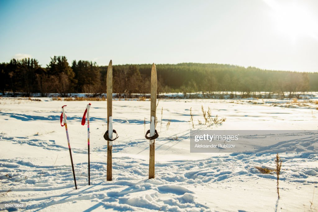 Skis and ski poles in snowy field : ストックフォト