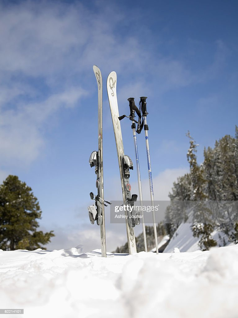 Skis and ski poles in the snow : Stock Photo
