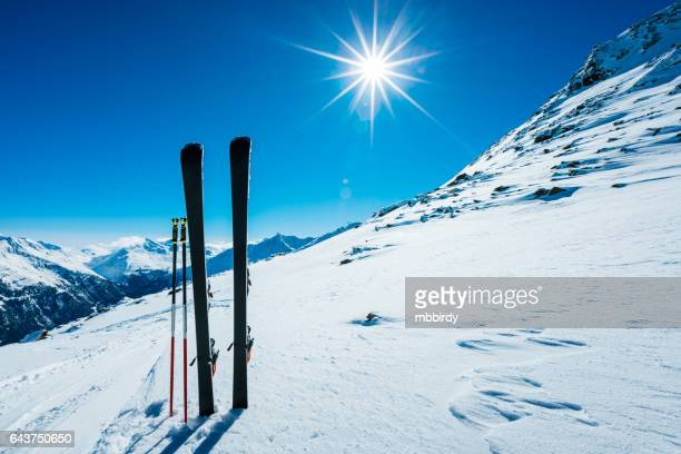 Skis and ski poles on remote slope