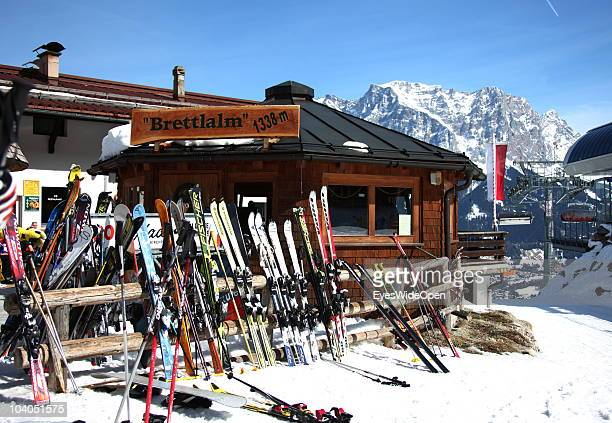 Skis are parked at the ski hut restaurant bar Brettlalm with panoramic view of the mountain Zugspitze on March 19 2010 in Lermoos Tyrol Austria The...
