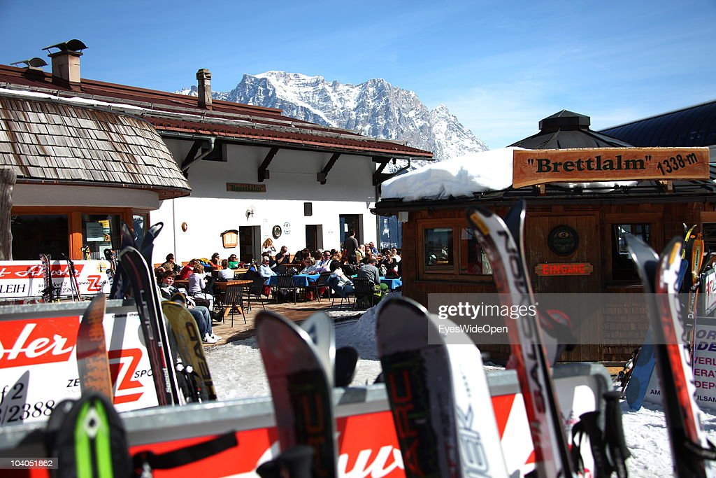 Skis are parked at the ski hut restaurant bar Brettlalm with panoramic view of the mountain Zugspitze on March 19, 2010 in Lermoos, Tyrol, Austria. The Zugspitze has got an altitude of 2962 meters and is the highest mountain and only glacier of Germany.