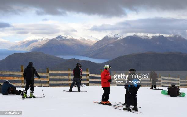 Skis line up in the snow as demos for guests to use at Coronet Peak on July 31 2018 in Queenstown New Zealand Coronet Peak is a ski field In...