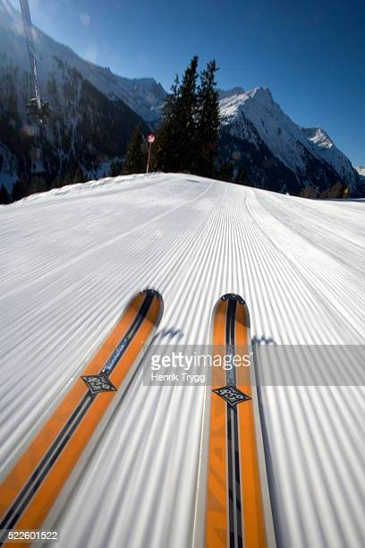 skis on ski slope - image stock-fotos und bilder