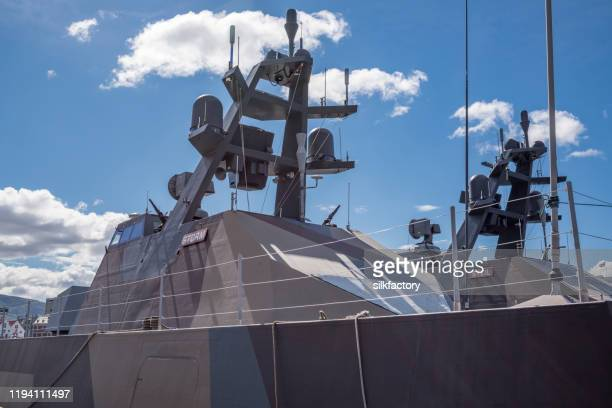 skjold class corvettes of royal norwegian navy in bergen harbor on sunny day in spring - warship stock pictures, royalty-free photos & images