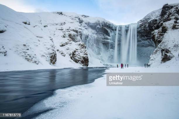 skogafoss panorama in winter - falling water flowing water stock pictures, royalty-free photos & images
