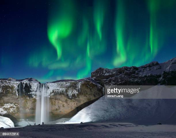 Skogafoss Waterfall and Green Aurora, Iceland