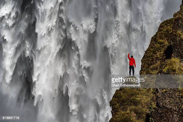 skogafoss waterfall at the skoga river , iceland - wasserfall stock-fotos und bilder
