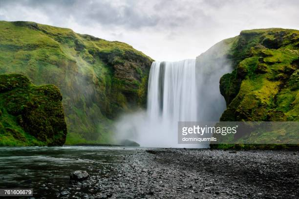 skogafoss waterfall, southern iceland - falling water stock photos and pictures