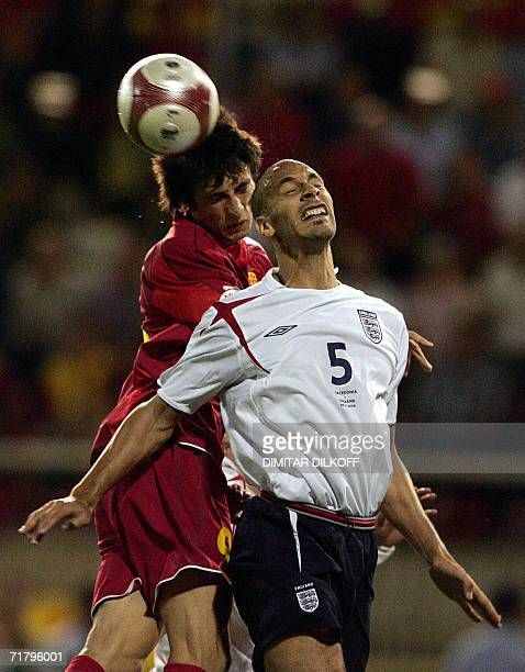 English defender Wes Brown vies for the ball with Macedonia's forward Goran Maznov during their Euro 2008 Championship qualifying match in Skopje 06...