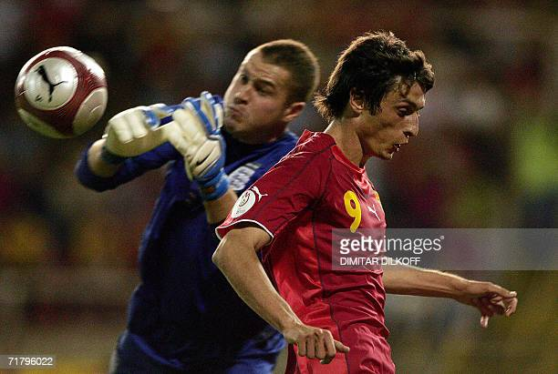 English Goalkeeper Paul Robinson vies for the ball with Macedonia's forward Goran Maznov during their Euro 2008 Championship qualifying match in...