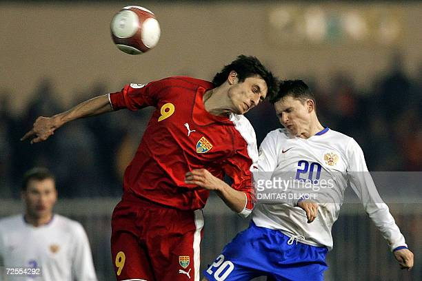 Macedonia's forward Goran Maznov and Russia's midfielder Igor Semshov jump for the ball during their EURO 2008 qualifying match in Skopje 15 November...