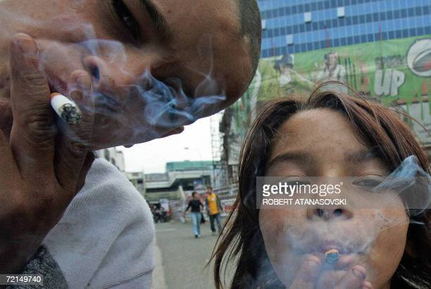 Roma children beggars smoke on the city square of Skopje Macedonia 12 October 2006 Underage smoking is widespread in Macedonia especially among the...