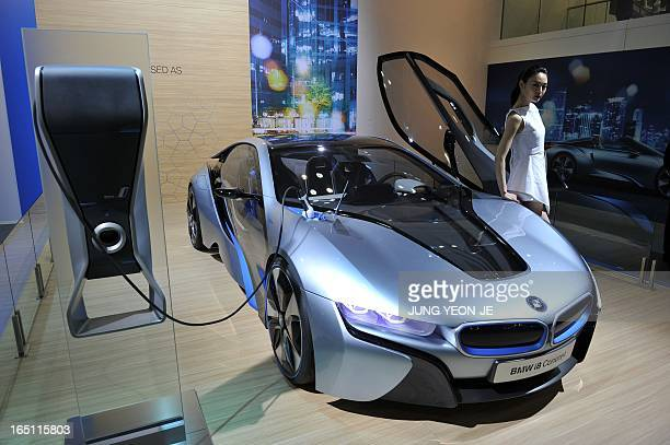 SKoreaautoshowFOCUS by Jung HaWon This picture taken on March 28 2013 shows a South Korean model posing with BMW i8 Concept during a press preview of...