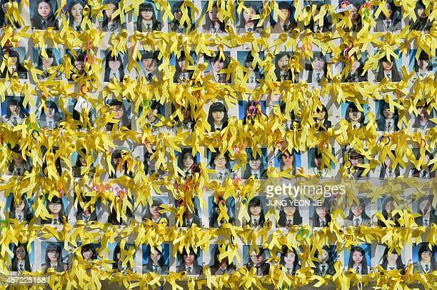 SKoreaboataccidentFOCUS by Giles HEWITT Portraits of the victims of the sunken South Korean ferry 'Sewol' are seen with yellow ribbons at Gwanghwamun...