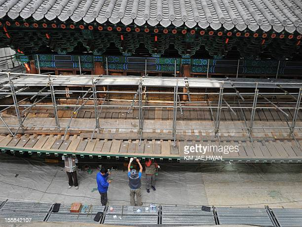 STORY SKoreacultureheritagegateFEATURE by Nam YouSun In this picture taken on October 9 craftsmen restore South Korea's foremost historical treasure...