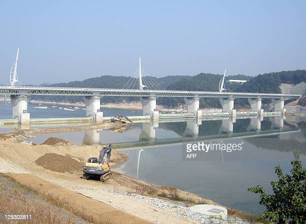 SKoreaeconomyenvironmentriversFOCUS by Lim ChangWon In a picture taken on October 8 2011 heavy equipment is used by workers to construct the Gangchon...