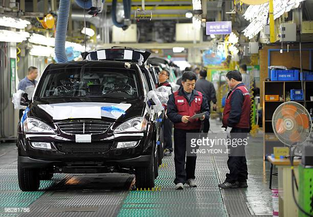 SKoreaeconomylabour by Jun Kwanwoo South Korean employees of Ssangyong Motor work on the factory line at the Ssangyong plant in Pyeongtaek 70...