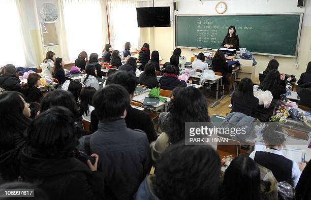 SKoreaeducationpunishmentFEATURE by Jung HaWonThis photo taken on February 10 2011 shows South Korean students sitting in a classroom during their...