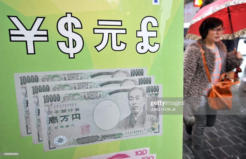 SKorea-Japan-economy-trade-forex,FOCUS by Jung Hawon This photo taken on February 1, 2013 shows a woman walking past a currency exchange sign illustrating a Japanese banknote at a shopping district in Seoul. A surging won and waning yen are eroding the bottom lines of South Korea's export powerhouses who are feeling the pinch after years of gobbling up global market share from their Japanese rivals.