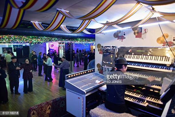 SKorealifestyleculturepopulationageing FEATURE by Jung HaWon In a photo taken on December 2 2015 a musician plays keyboards as people dance at a...
