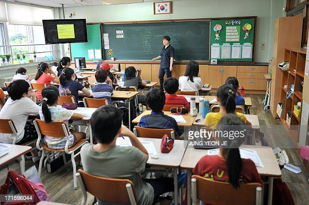SKoreatechnologyITaddictionhealthFEATURE by JUNG HaWon This picture taken on June 11 2013 shows South Korean children during a special class on...