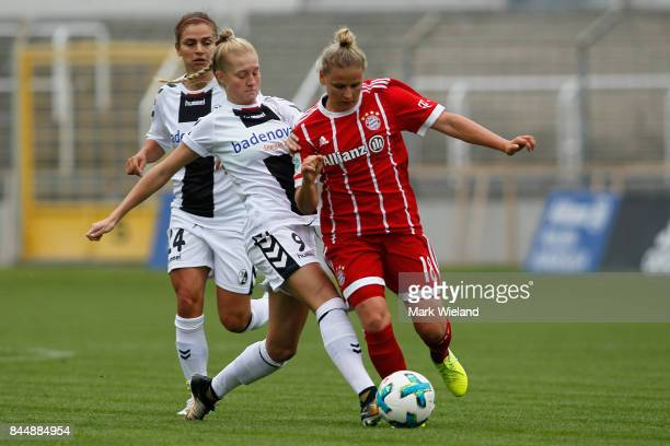 Skorvankova of Bayern Muenchen and Janina Minge of SC Freiburg in action during the women Bundesliga match between Bayern Muenchen and SC Freiburg at...