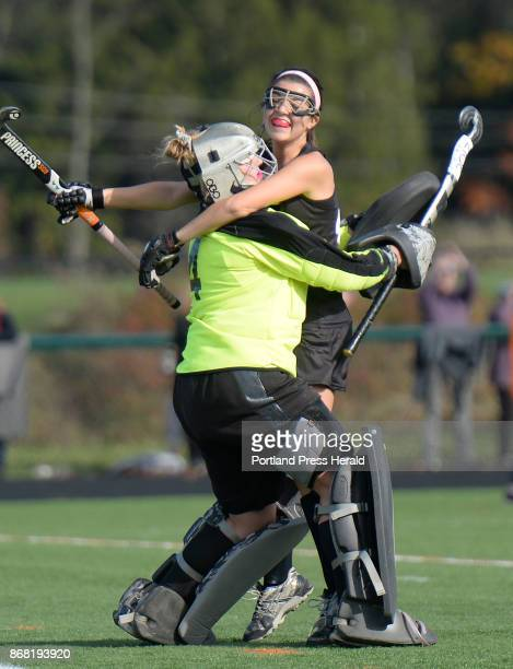 Skowhegan's Haley Carter jumps into the arms of goalie Leah Savage after winning the state championship vs Westbrook Saturday October 28 2017