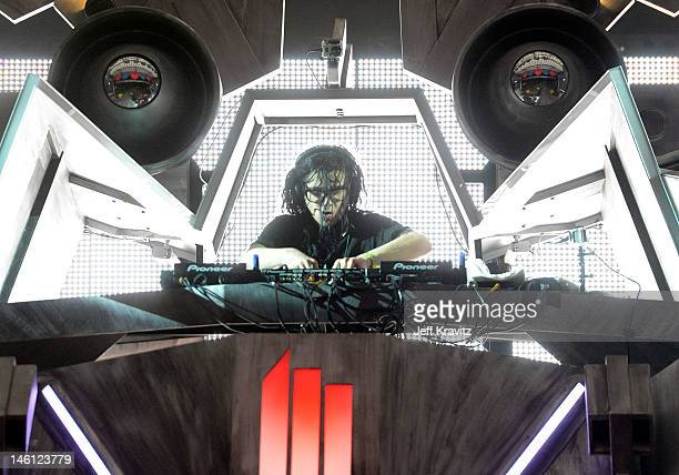 Skrillex performs onstage during Day 3 of Bonnaroo 2012 on June 9 2012 in Manchester Tennessee