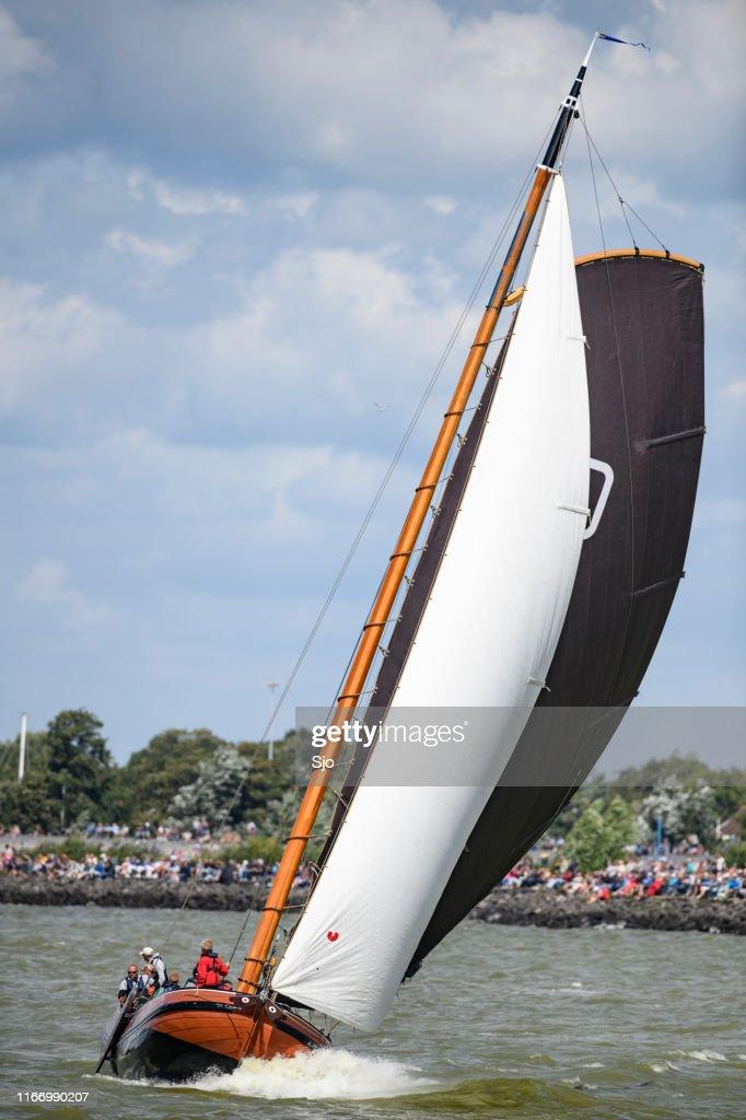 Skûtsje of Drachten Classic Frisian sailing Tjalk ship during the 2019 annual SKS Skûcheksilen : Stock Photo