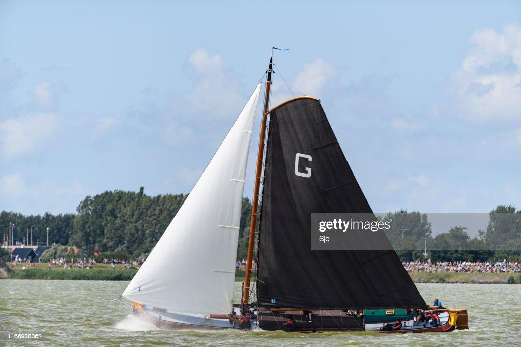 Skûtsje of Grou Classic Frisian sailing Tjalk ship during the 2019 annual SKS Skûcheksilen : Stock Photo
