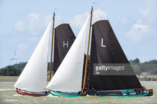 Skûtsje of Heerenveen and Lemmer classic Frisian sailing Tjalk ships during the  2019 annual SKS Skûtsjesilen
