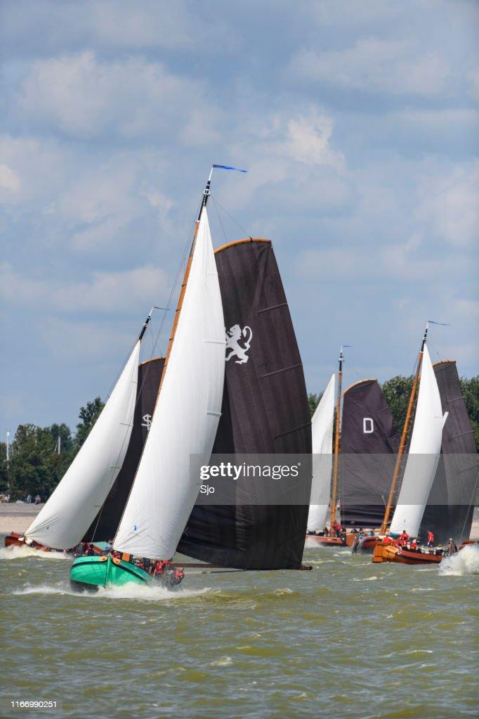 Skûtsje of Leeuwarden Classic Frisian sailing Tjalk ships during the 2019 annual SKS Skûcheksilen : Stock Photo